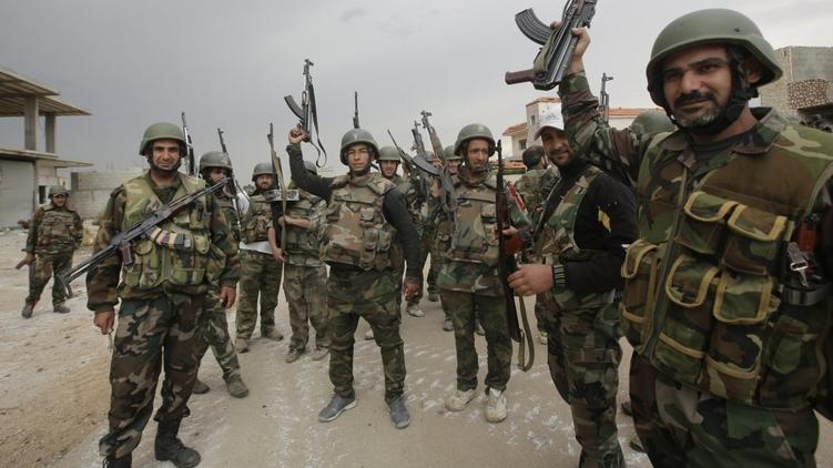 Армия Башара Асада отмечает возвращение древней Пальмиры под контроль правительственных войск, фото: 123ru.net